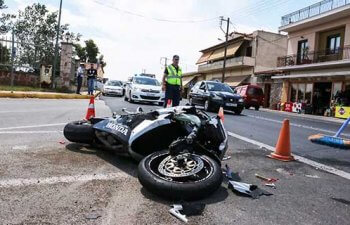 Traffic accident between a car and a motorcycle.